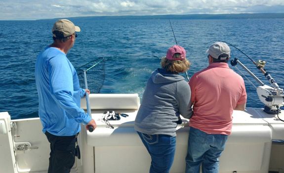 Fishing trips and boat cruises plumbers helper charter for Michigan fishing license price